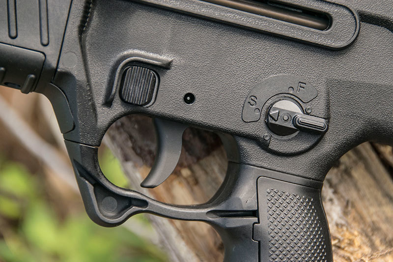 The new civilian-legal X95 the magazine release is located forward of the trigger guard rather than adjacent to the magazine well.