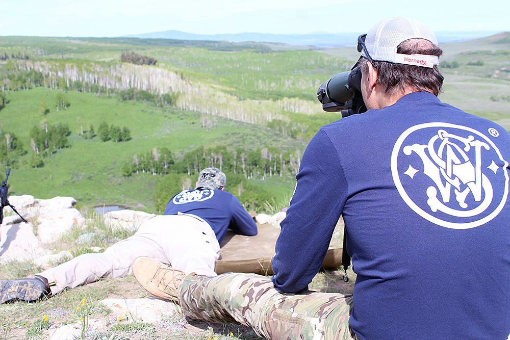 "Spotter/shooter communication was even more important in field conditions. We noticed that while there was a stiff breeze coming from the right at our shooting positions, down at the target, the spotting scopes told us the air was still. ""Center hold, send it!"""