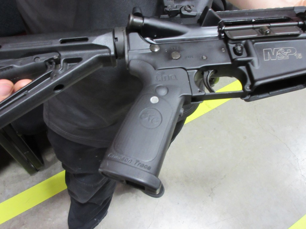 Operating controls of the Crimson Trace LinQ are on the pistol grip for instinctive activation.