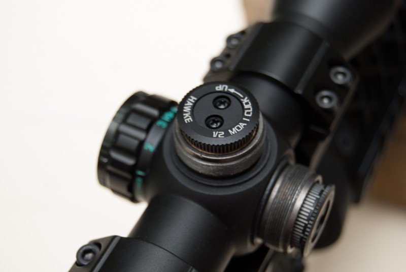 The elevation direction is clearly indicated on this Hawke optics scope. Each click in the counter-clockwise direction moves the bullet impact up ½-inch at 100 yards.